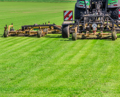 Industrial lawn-mover cutting the grass