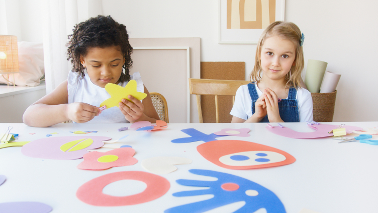 Two kids doing some artwork